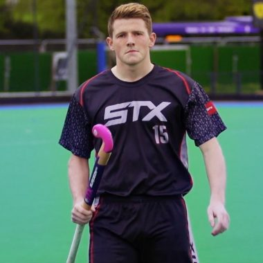Sam Ward with STX hockey sticks